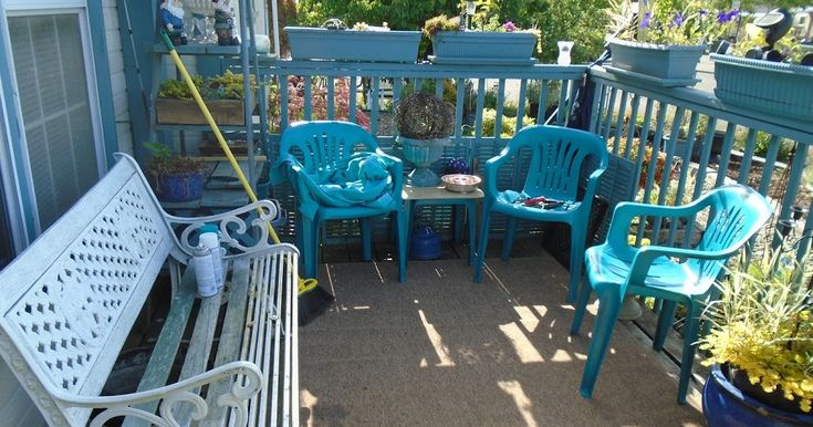So...here's my front deck in the middle of the warm weather fix up. I spray painted the plastic chairs a bright turquoise and found a borin...