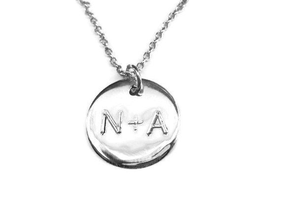 A personalized circle pendant necklace ideal gift from your friends or your bridemaids.  Choose your favorite monogramm and please leave a note in your order.The chain is included in the price.The letter or the letters are engraved.    The disc and the chain is made from solid SILVER 925.The necklace is also available in 18kt gold plated silver.