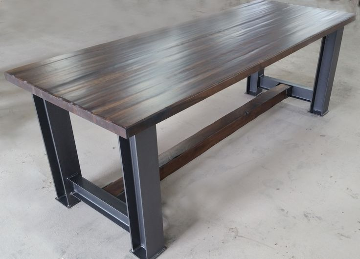 Raphael table- Walnut table top and trestle with solid steel I-beam legs.