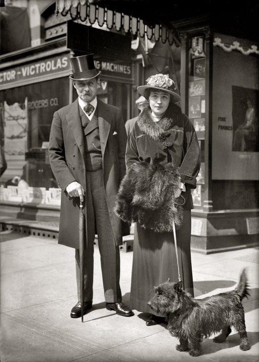 "1915 Walking the dog outside a Victrola ""talking machine"" store in Washington, DC."