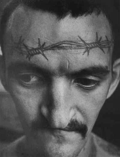 Russian prison tattoo:  Barbed wire tattooed across the forehead signifies life sentence without possibility of parole