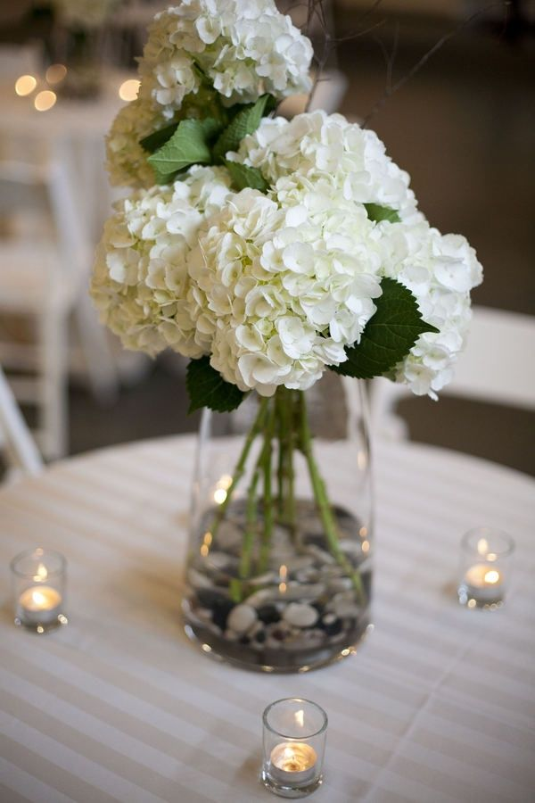 White hydrangea centerpieces with rocks pretty simple