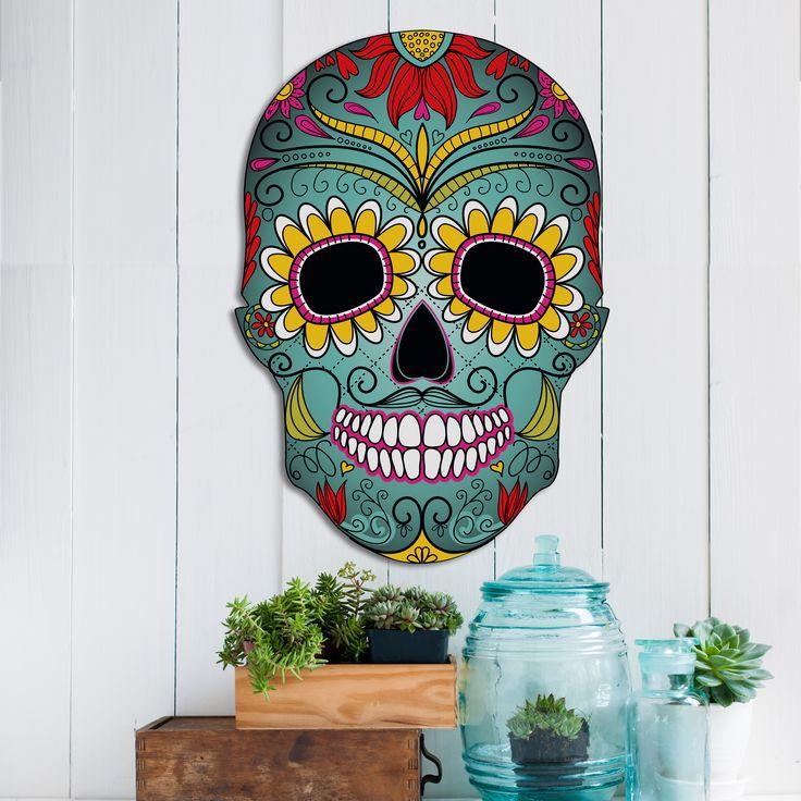 Das auffällige bunte Wandobjekt kombiniert das angesagte Design eines Totenkopfes mit bunten Blumen und Ornamenten in verschiedenen knalligen Farben. Die Farbpalette reicht von einem kräftigen Gelb über Pink und Lila. Schmücken Sie mit dieser einmaligen farbenprächtigen Skull-Wanddeko ihre modern eingerichteten Räume!