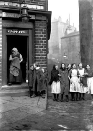 Christopher Pratt 1910, Bradford, UK These women passing Popplewell's grocery shop on Seymour Street are dressed for work in a mill: in 1910 the wool industry was heavily dependent on female and child labour. Pratt was a Methodist industrialist who created a rich photographic record of Bradford life.