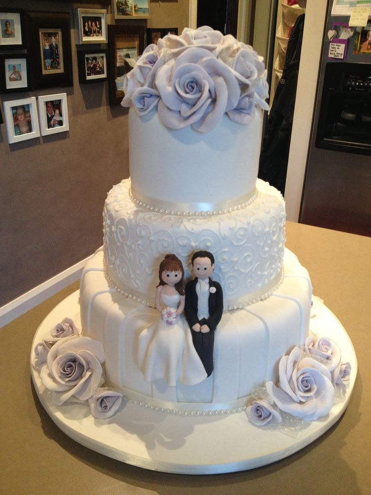 3 tier wedding cake with lilac hand made sugar roses9
