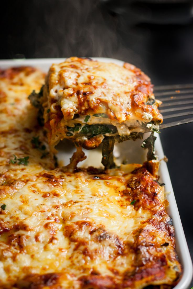 This vegetarian lasagna is comfort food at it's best. Stuffed with herbed ricotta, mushrooms, and kale and topped with delicious melty cheese.