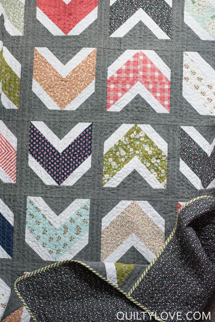 Quilty Arrows Quilt pattern is a fat quarter friendly quilt pattern. This is a new twist on modern arrow quilts or chevron quilt designs. Beginner friendly!