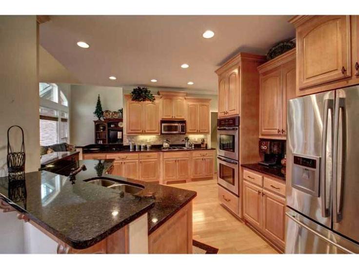 kitchen: stainless steel, dark granite counter tops, light ... on Maple Kitchen Cabinets With Dark Wood Floors Dark Countertops  id=47824