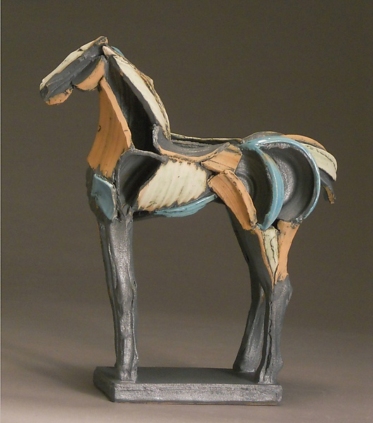 Earthenware horse figure finished with copper blue slip and glaze, and black copper glaze, fired to cone 04 in an oxidation atmosphere. The work is constructed from extruded and thrown forms that are cut apart and reassembled in the wet stage.