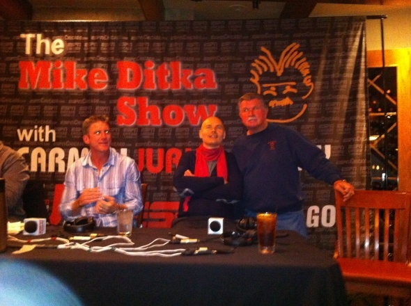 Smashing Pumpkins frontman Billy Corgan, center, pals around with legendary Chicago Bears coach Mike Ditka and ESPN Radio host Tom Waddle during the weekly radio program. (November 25, 2011)
