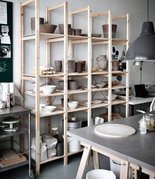 Pottery stored in IVAR solid pine shelving unit