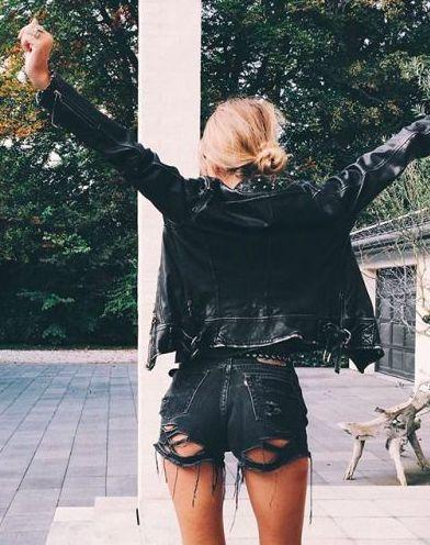 Black cutoff shorts and black jacket