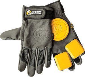 """Sector 9 Surgeon Slide Gloves S/M Charcoal/Black by Sector 9. $61.95. Sector 9 Niner Surgeon Slide Gloves S/M-char/Blk/Yel. Black Leather with Contrast Color Knuckles, All Black Stealth w/ Black Pucks, Adjustable Wrist Guard with Logo Embroidery, (2) 9-Ball Hand Pucks and (4) Double Finger Pucks, Reinforced Leather Thumb, Industrial Strength Velcro, Top Panel Lining / """"Bert Logo"""" Hot Stamp"""