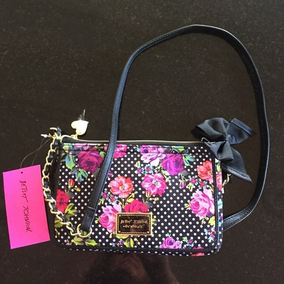 Sale!!! Betsey Johnson bag Betsey Johnson crossbody wallet bag, zip area and lift pocket for wallet area.  Very beautiful, iconic black & pink flower pattern.  New with tags attached. Betsey Johnson Bags Crossbody Bags