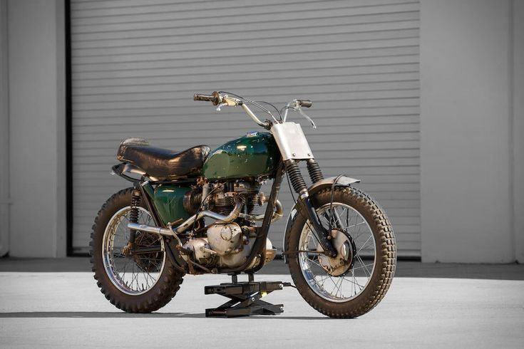Plain looks, famous owner. Steve McQueen's 1963 Triumph Bonneville Motorcycle is an exciting piece of motoring history, and not just because of the star who rode it. Bud Ekins, a friend of and stunt double for McQueen and a well-known motorcycle racer himself, modified the bike for off-road racing.