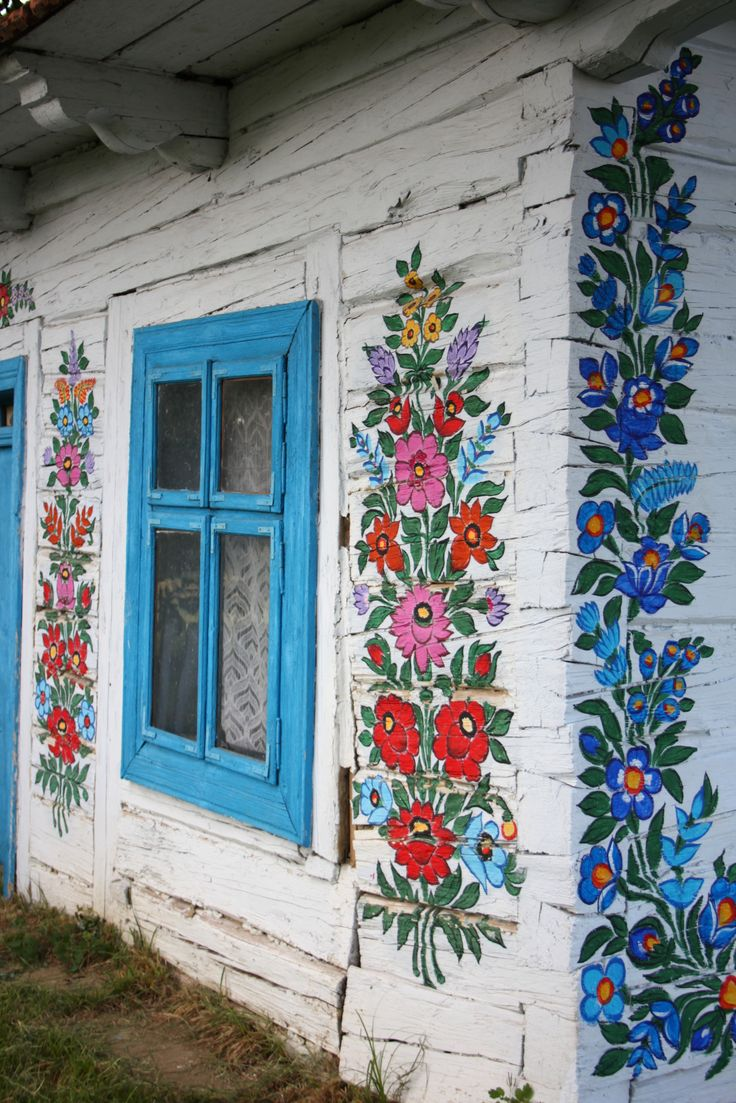 Window, Zalipie, Poland. A cottage in Zalipie, Poland, a village about 40 miles east of Krakow. Around 20 houses are adorned with floral paintings in the style of a famous ceramics artist, Felicja Curylowa, who lived in the village. Today, local women are taught how to paint in her style and anything that can be painted - is painted.