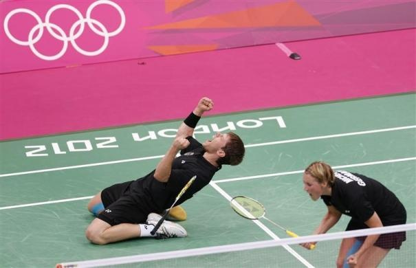 Germany's Michael Fuchs (L) and Birgit Michels celebrate after defeating Britain's Chris Adcock and Imogen Bankier in their mixed doubles group play stage badminton match at the Wembley Arena during the London 2012 Olympic Games July 29, 2012.   REUTERS/Bazuki Muhammad