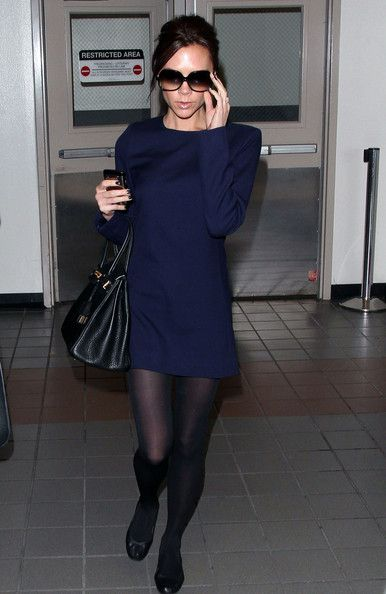 "Victoria wore the long-sleeved, navy blue ""Shift Dress"" with sheer black tights and black flats."