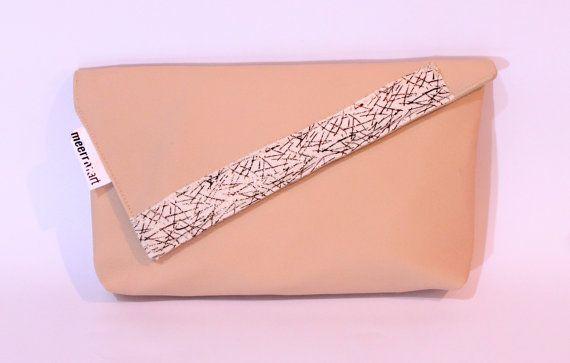 Beige clutch bag with golden strip upholstery by meerrorart