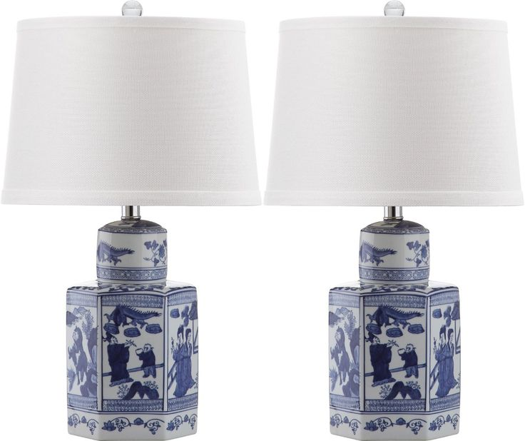 Inspired by an antique Chinese porcelain apothecary jar, the artfully painted Judy table lamp is a blue and white classic for traditional rooms. Crafted of ceramic with silver neck, this set of two intricate lamps is topped with a textured cotton shade. Measures 14