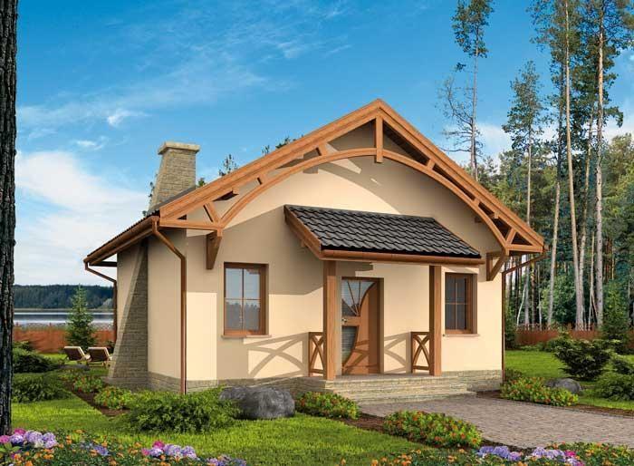 Dom jest wyjątkowy także ze względu na starannie dobrana kolorystykę ciepły beż elewacji, równie ciepły brąz drewnianych wykończeń oraz miękkie szarości dachówki, kamiennych podmurówek, schodków i efektownego komina tworzą oryginalną kompozycję estetyczną.