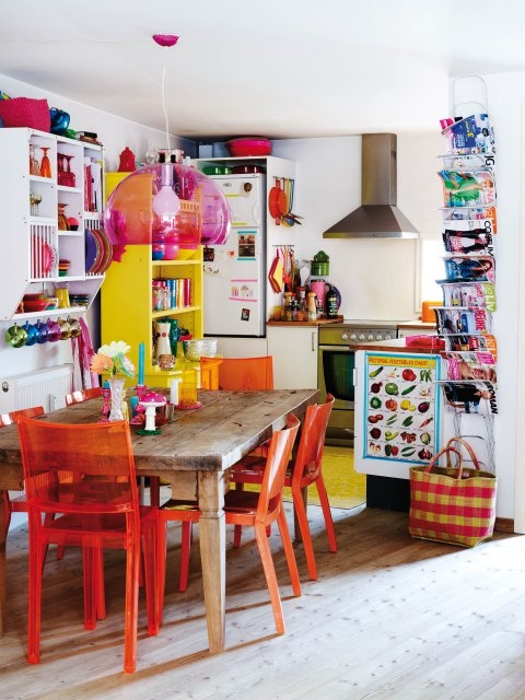 Colorful kitchen with fun red kitchen chairs