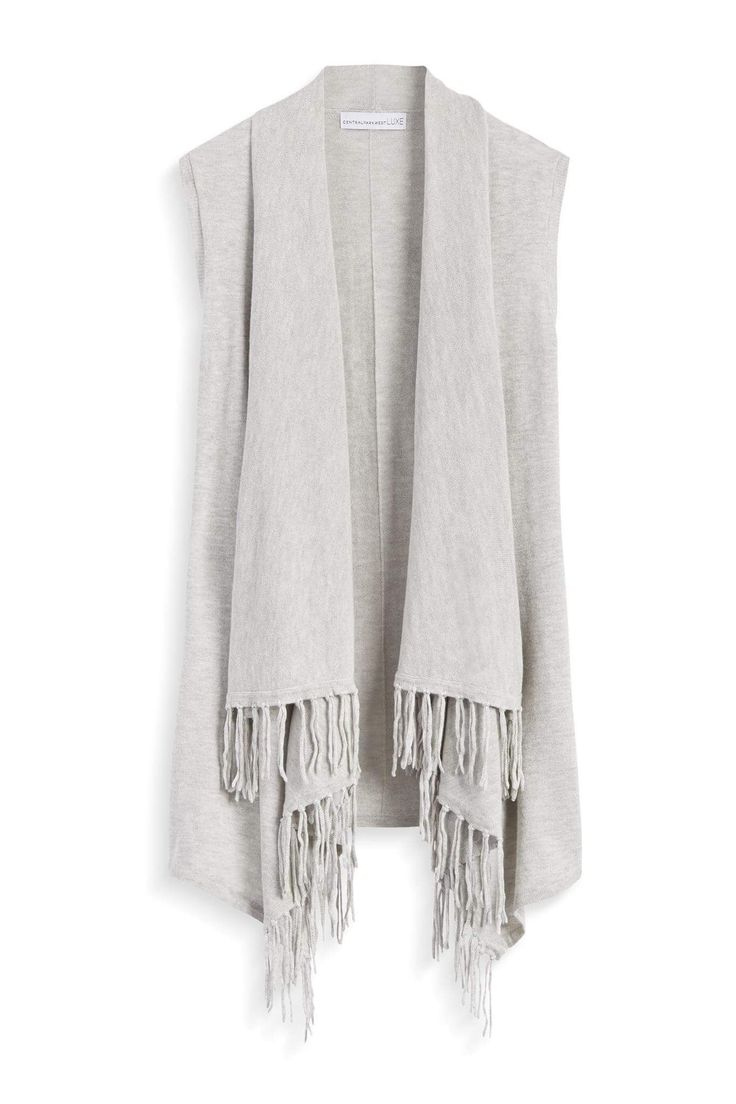 I ADORE this gray fringe vest from Stitch Fix! Sign up today and request this top in your very first fix! Just click the image to get started. #affiliate