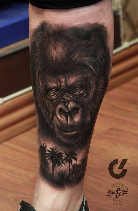 Black and grey gorilla tattoo on the right lower leg.