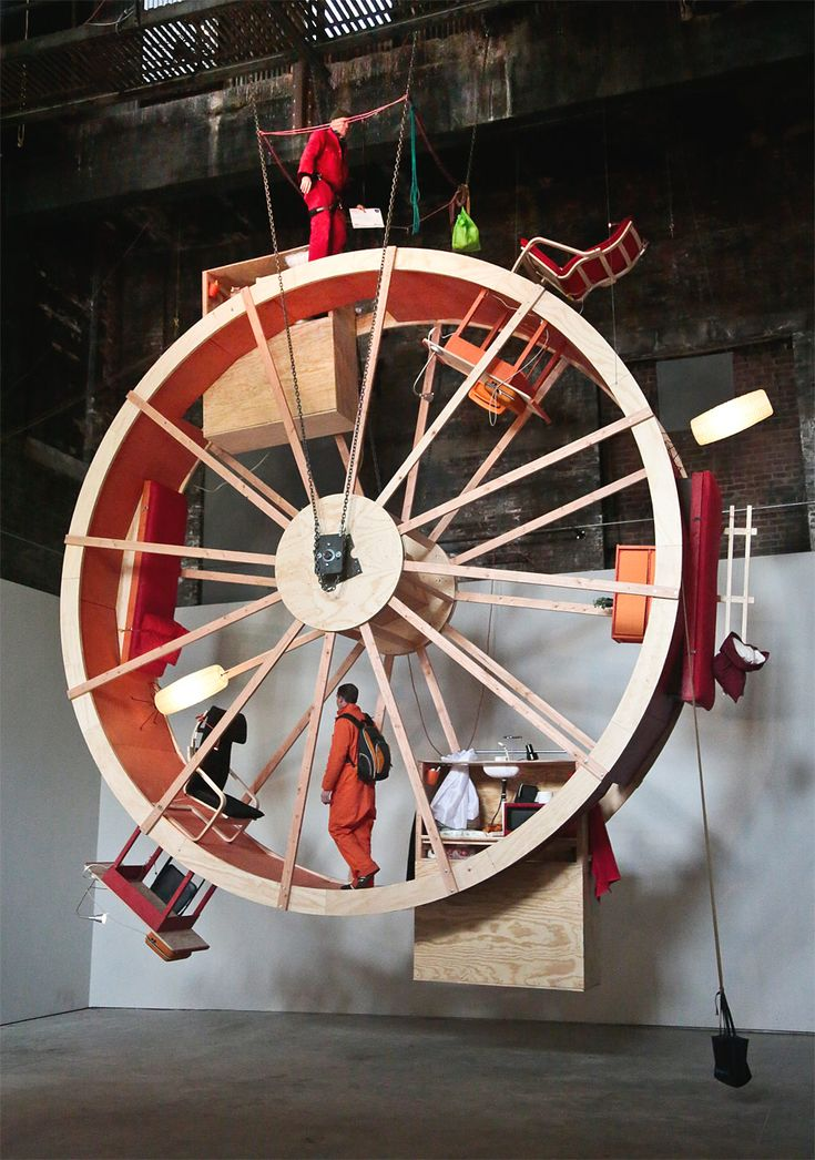 """In Orbit Alex Schweder and Ward Shelley  """"One definition of art: do a dumb thing in a difficult way."""" -- Brooklyn artist Ward Shelley, who is spending 10 days in a """"hamster wheel."""""""