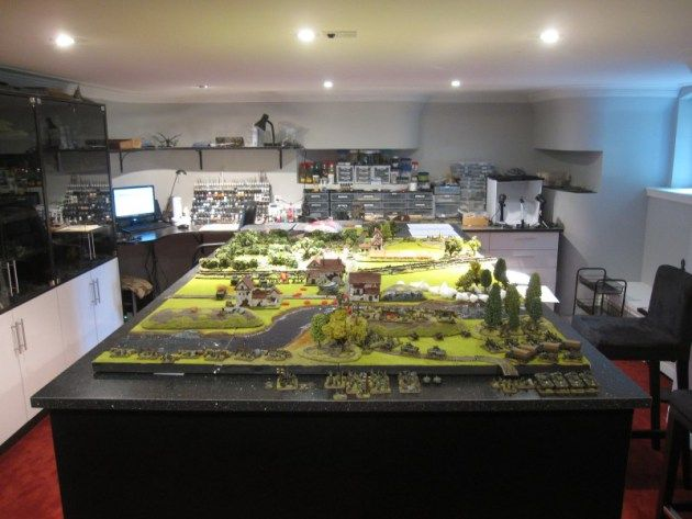 Crazed tabletop gamer Helge, who runs the blog Wargaming Workshop, has built the ultimate wargaming room. The spacious, carpeted, and well-lit room is big enough to house a 4' x 8' terrain board an...