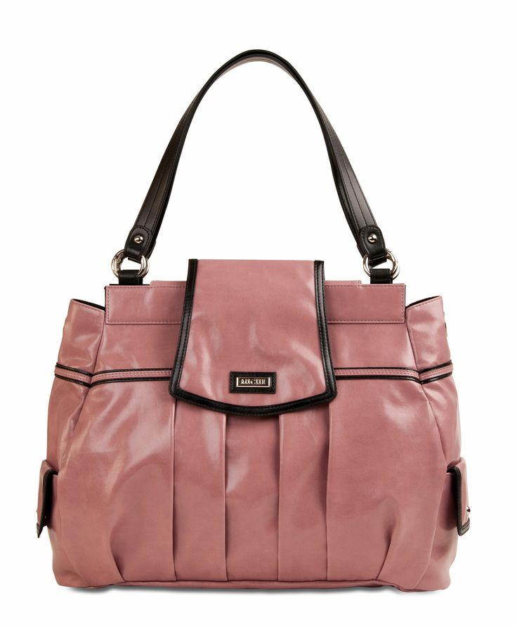 """*Miche Canada* The soft pearlized cotton candy colour and classic styling of the Laney Shell for Big Bags will have you """"tickled pink"""" every time you reach for your handbag. But don't let this Shell's demure demeanor fool you: perfectly-placed black faux leather detailing, chic over-the-top closure and side pockets with metal rivets give this Shell just the right amount of """"edge"""" for today's modern woman."""