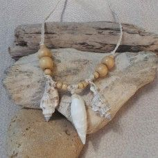 Shell Necklace: Natural: 3 Shells.  Shell reminds us of summer where the splash of waves, blue skies and warm breeze are most welcome after winter.  Summer is a carefree time when relaxation moves to the forefront as holidays arrive. We remember the beach as children playing in the sand, listening to shells and jumping through waves. Eventually shells wash-up on the shore and we are reminded of the familiar story of change and growth. $18.00au