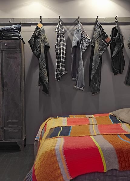 the hooks. Boys room. This picture is stupid with the jeans, nt I love the idea of hooks along the wall