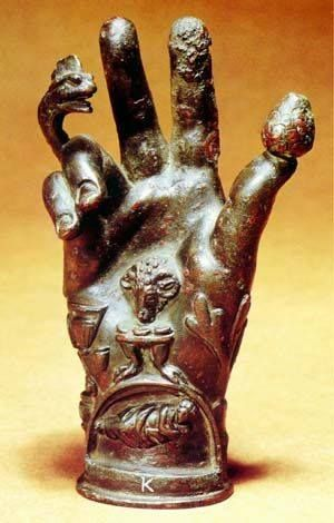 Bronze hand: dates from the late Roman Empire, when all forms of divination from scrying to astrology, flourished. The hand bears the symbols, such as a cockerel's head and a pine cone, of the Roman mystery cult of Dionysus