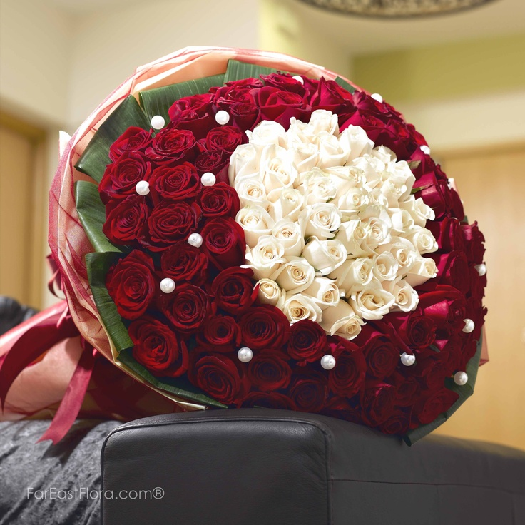 PT27 - Love, Actually  Say it loud, say it clear, and say it dear - the way only roses can! When you want to make the ultimate statement, let these lovely petals do the talking. Red roses studded with shimmering pearls, encircling creamy white roses within... she'll get the message.