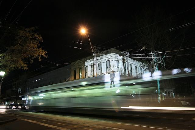 Gertrude Street projections 2011 (long exposure) - Man on  a tram