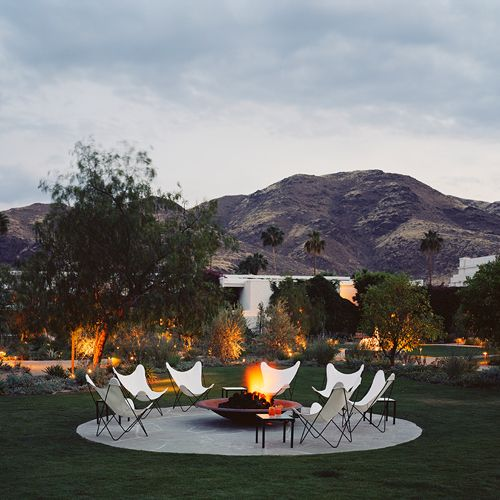 Butterfly chairs around firepit PARKER PALM SPRINGS.. Elsyian landscapes.