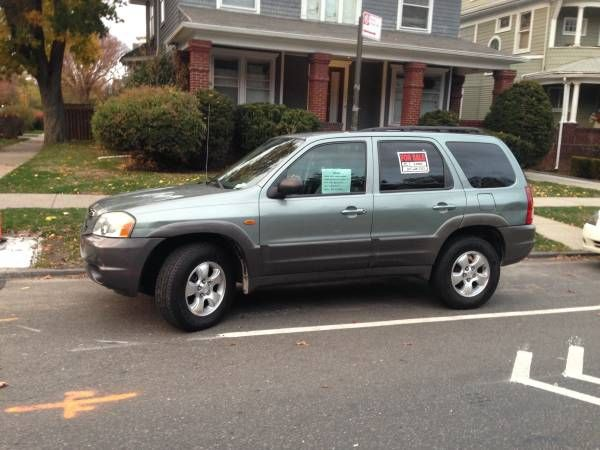 2003 MAZDA TRIBUTE LX. CHEAP/RELIABLE/GREAT ON GAS SUV. WINTER READY!!