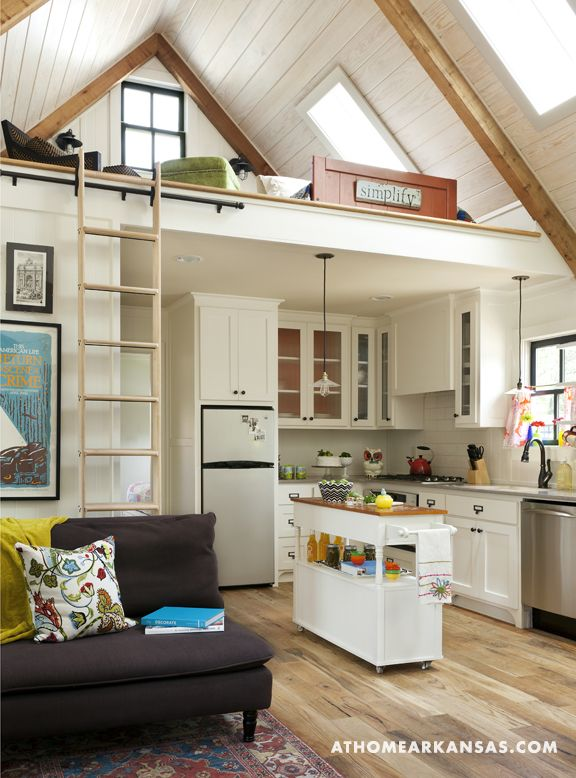 A loft above the kitchen and living area offers extra space for overnight guests. Wood-beam rafters add to the home's charm and Arts-and-Crafts aesthetic; wood floors throughout are unfinished oak.