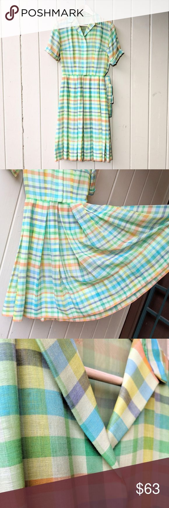 Vintage 1950s Spring Dress S Welcome spring with this vintage dream dress! '50s or early '60s in yellow, green, orange, blue, purple plaid. Plenty of room in the pleated skirt to poof it out with a crinoline. Original belt included! Hidden buttons, hook closure at waist. Torso has a solid yellow sheer lining; skirt is unlined. Dress is sheer, so you'll need a slip. 1 belt loop is detached at the top; a few holes in the sheer lining at the upper back (see photo - not noticeable when worn). B…
