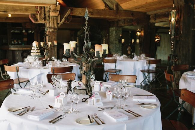 Rustic elegant setting - Kylie and Drew's wedding story. Overlooking spectacular sprawling gardens with a majestic view of Lake Hayes, rustic in ambience and overflowing with magical charm. www.trulyandmadly.com #wedding #real #table #setting