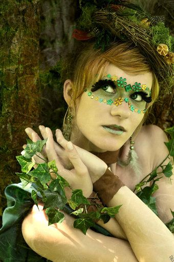 "Green and yellow jewels enhance this nature themed fantasy make-up look... titled ""Forest Fantasy""."