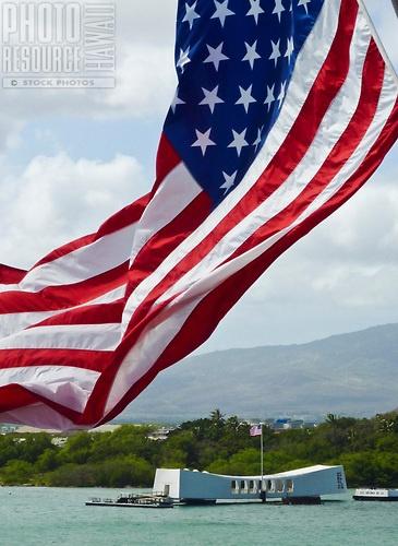 An American flag flying near the USS Arizona Memorial, Pearl Harbor, Oahu.