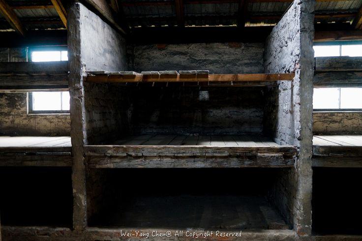 Inside a brick barracks for prisoners in Birkenau.   by wces2600
