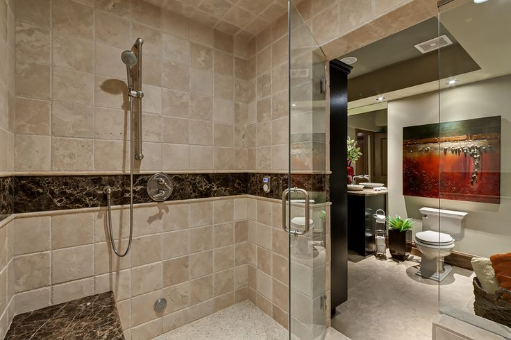 The man cave in the basement has a large steam shower, perfect to relax after a hot tub or after a long day. It includes a wooden pool table. TV and bar area so that you can have all of your friends over!