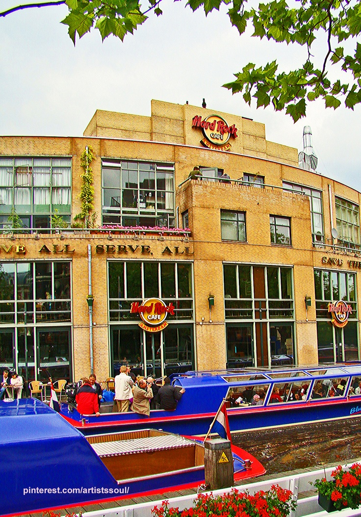 Hard Rock Cafe - Amsterdam... which we did not eat at... and the boat tour company that we took in the rain!