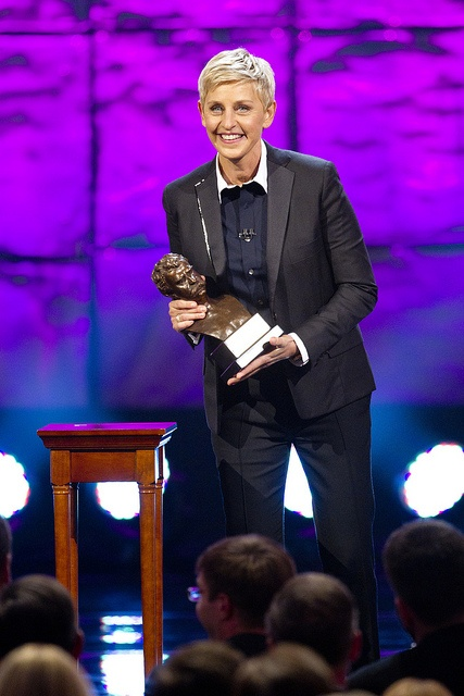 @Ellen DeGeneres accepts the bronze Mark Twain bust as the 15th recipient. (Credit: Scott Suchman)