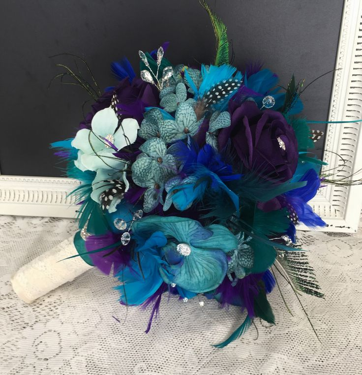 Peacock Wedding Bouquet, Feather Wedding Bouquet, Wedding Accessory, Peacock Bridal Flowers, Teal & Purple Wedding Flowers, Peacock Bouquet by DarlasBlooms on Etsy https://www.etsy.com/listing/492216746/peacock-wedding-bouquet-feather-wedding