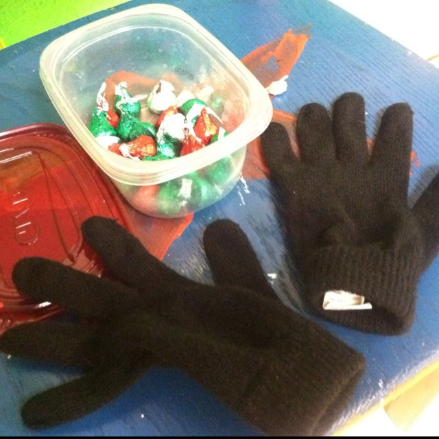 unwrap hershey kisses and also use the gloves (oversized) to carry a 'snowball marshmellow' on a spoon. to a bowl.