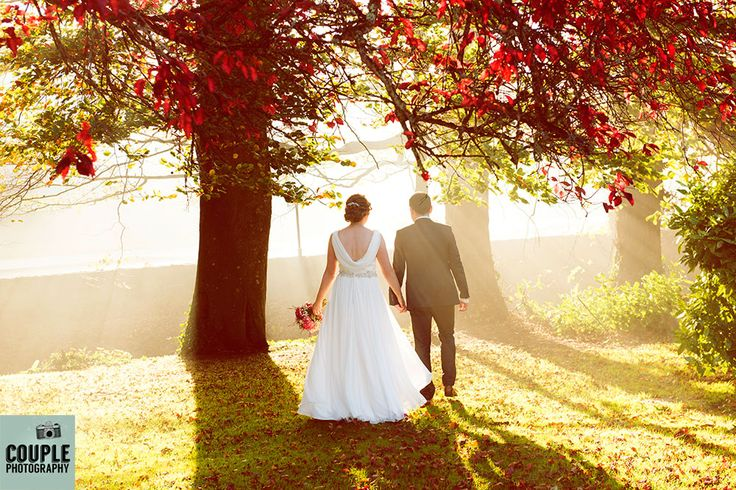 The newlyweds were greeted by beautiful Autumnal light as they came out of the church. Wedding on Halloween day. Wedding at Castle Dargan Hotel Photographed by Couple Photography. Ireland.